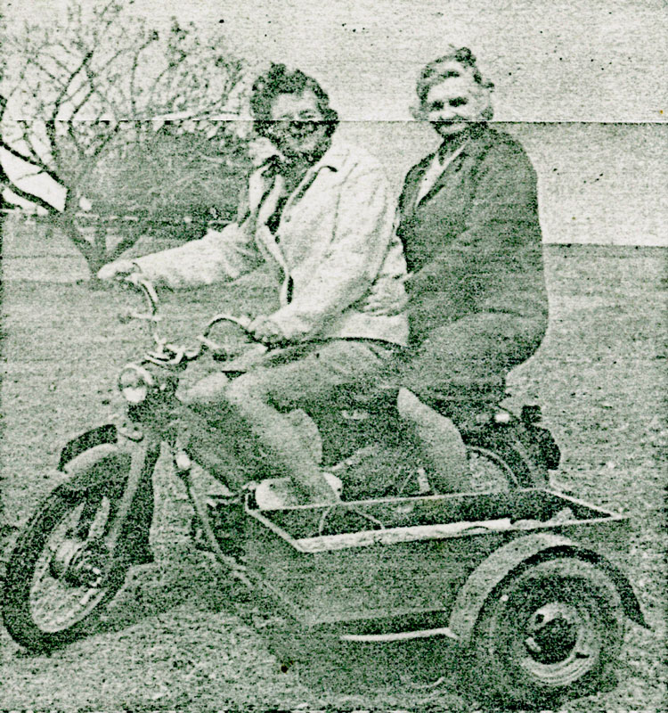 Mrs-Burton-and-Mrs-Cutton-on-bike-happy-valley-creased-photo